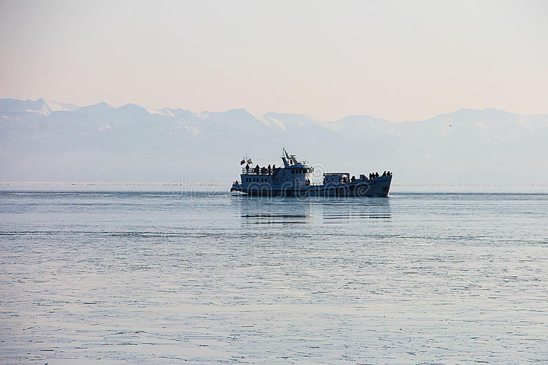 Download The Ship, Sailing On Lake Baikal Sayan Mountains In The Background. Stock Photo - Image: 83701314