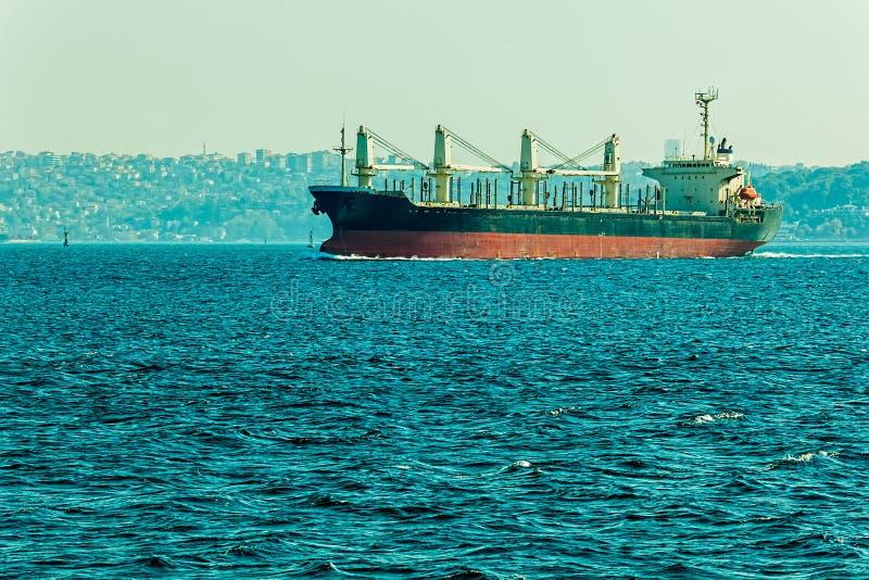 Ship sails Bosphorus. The ship sails Bosphorus on sunny autumn day royalty free stock image