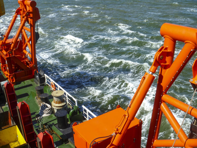Ship in the sea. The edge of the barge deck stock photography