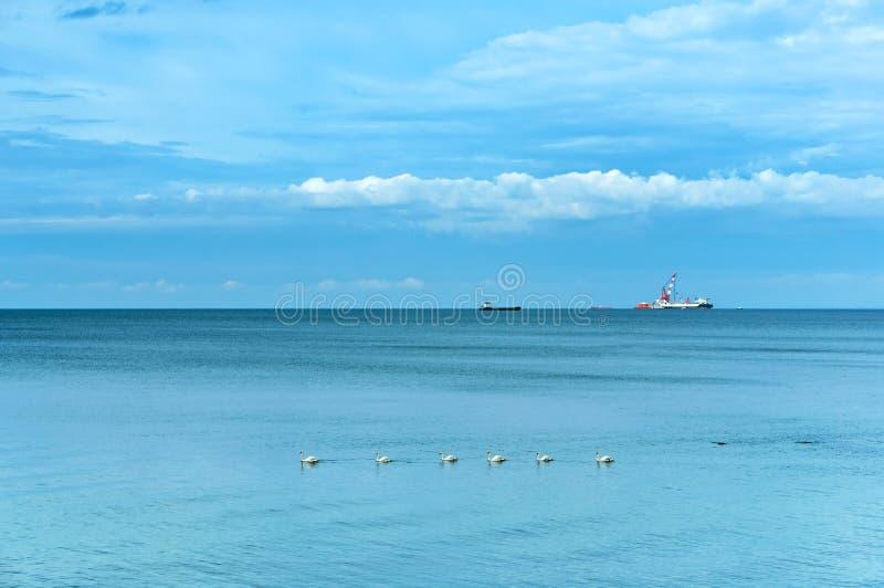 A ship at sea far away stock images