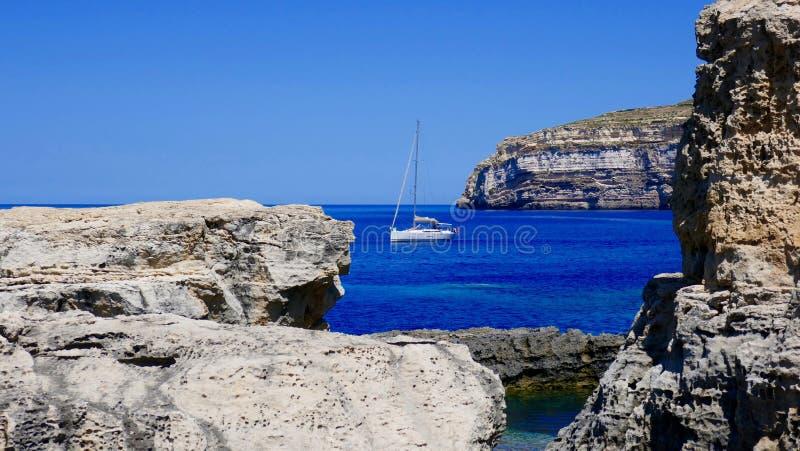 Yacht on the azuresea close to Malta's coast stock images