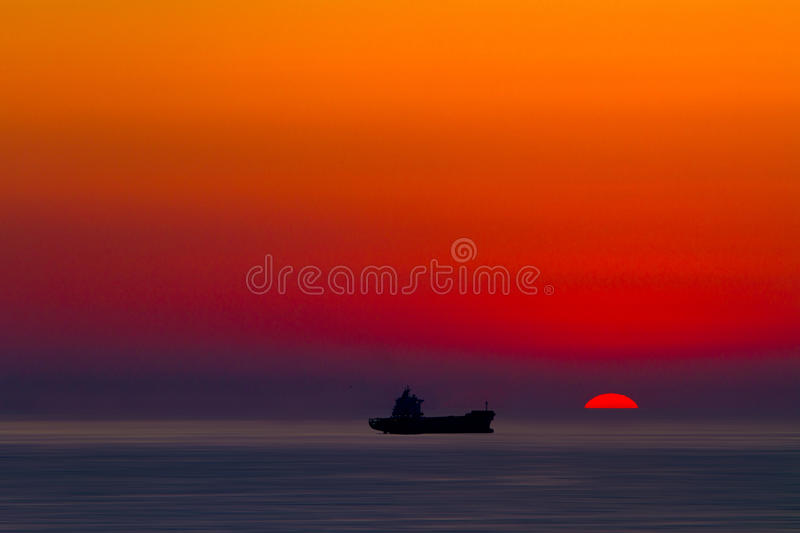 Download Ship silhouette at sunset stock photo. Image of seagoing - 25095910