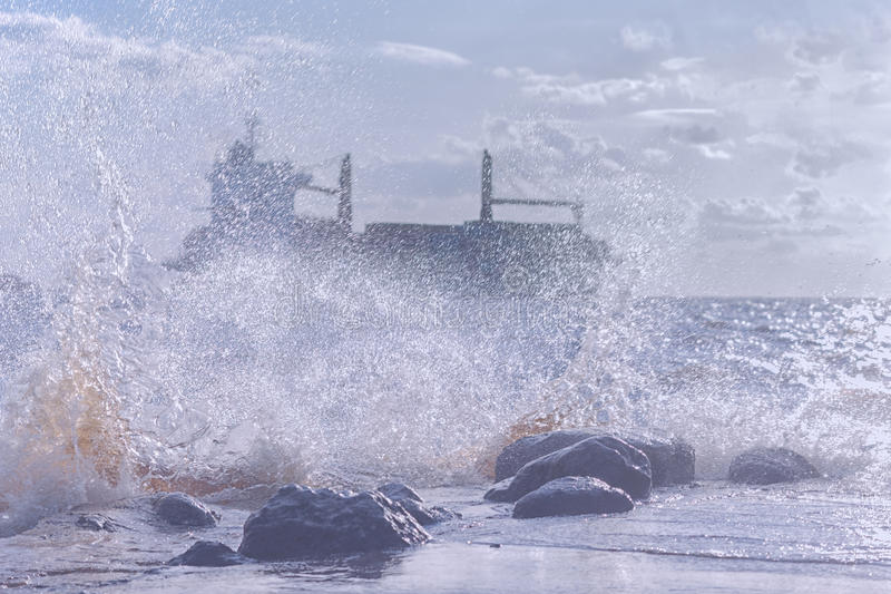 Ship in a stormy sea stock photo
