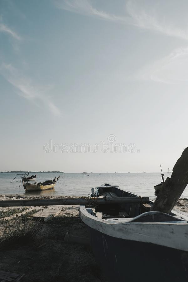 Ship and sun. Two empty boat in the beach Indonesia royalty free stock images