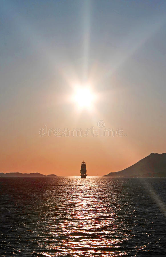 Ship in the sunset royalty free stock photo