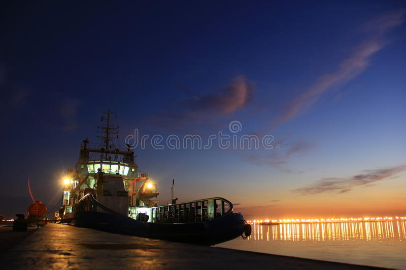 Ship in the sunset royalty free stock photography