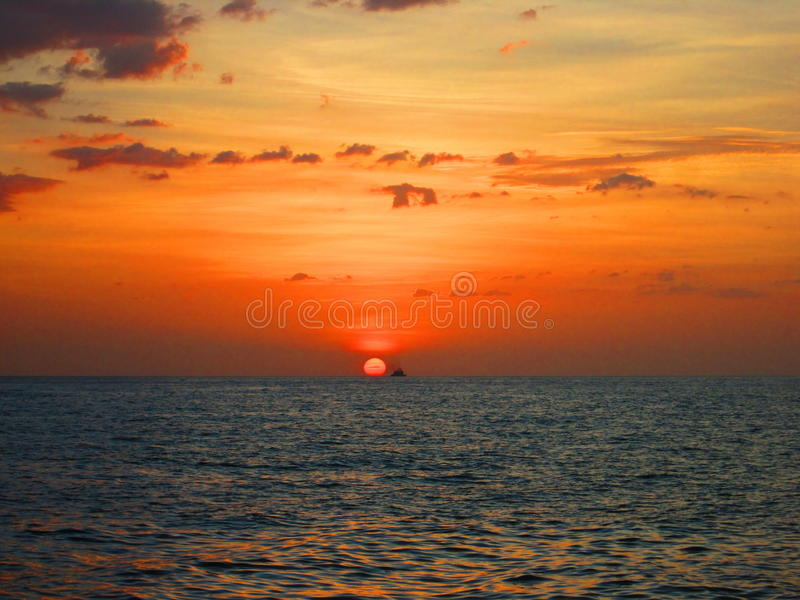 Ship at sunset on the beach royalty free stock photography