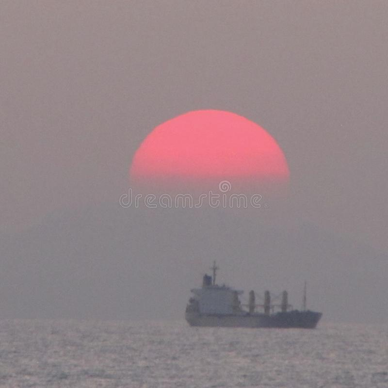 Ship with sunset stock photography