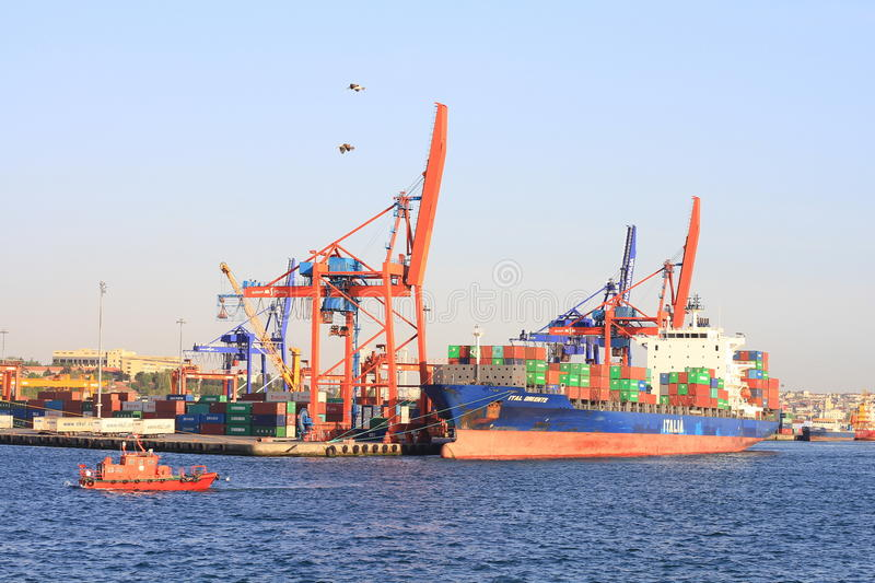 Ship to shore cranes working on the container ship royalty free stock image