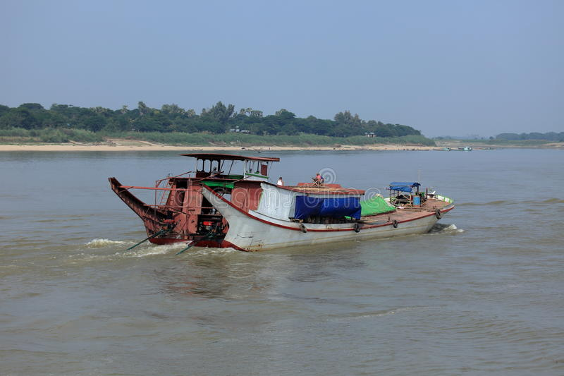 Ship traffic on the Irrawaddy in Myanmar. The Ship traffic on the Irrawaddy in Myanmar royalty free stock photos