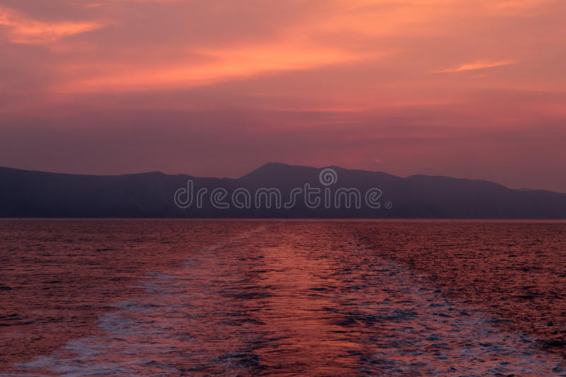 Ship trail on a summer evening sunset stock photography