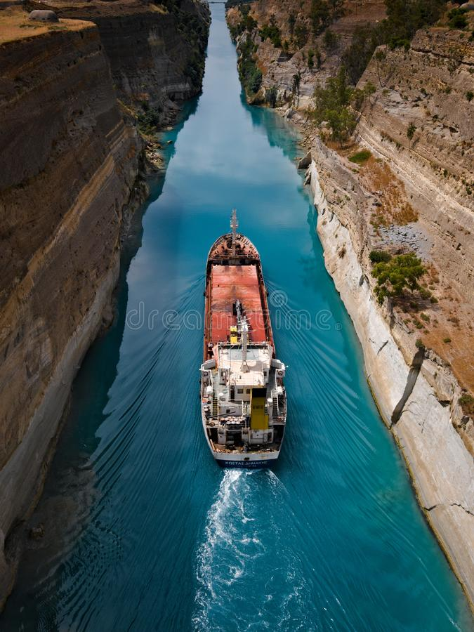Ship traveling through the canal of corinth. Big ship in small canal, landmark, narrow, tourist, greek, steep, historic, boat, bridge, nautical, transportation stock photos
