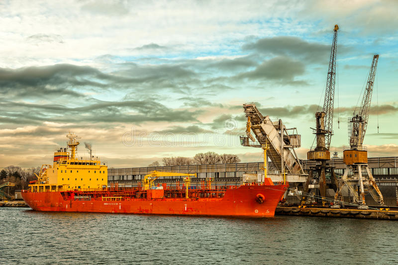 Ship under loading. Stone in Port of Gdansk, Poland stock photo