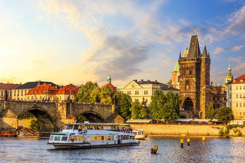 A ship in the Vltava near the Charles Bridge and Old Town Bridge royalty free stock images