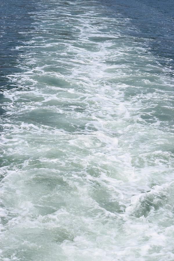 Ship Wake - Waves on Water Surafce caused by Moving Watercraft. This is a photograph of ship wake - trails or waves on water surface caused by moving watercraft stock photography