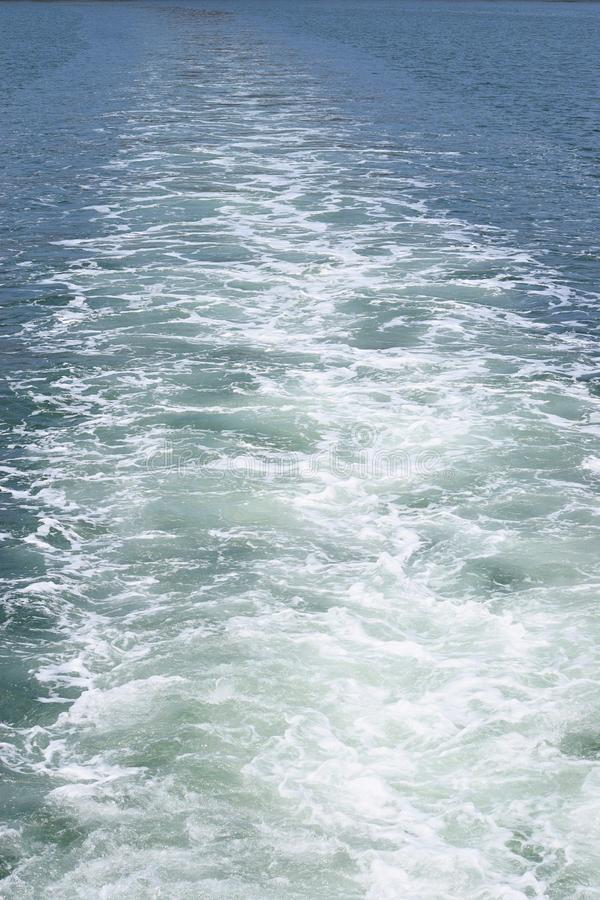 Ship Wake - Waves on Water Surafce caused by Moving Watercraft. This is a photograph of ship wake - trails or waves on water surface caused by moving watercraft royalty free stock photo