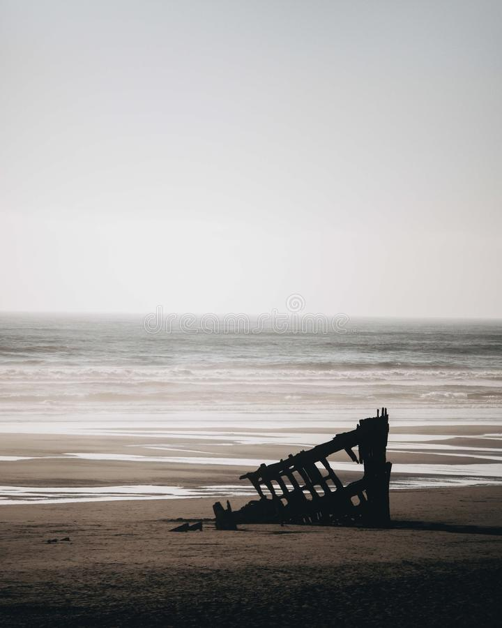 Ship wreck of the Peter Iredale. The Ship wreck of the Peter Iredale in front of the ocean stock photography