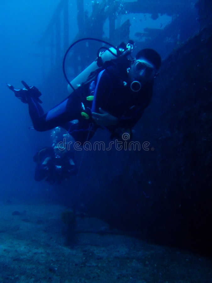 Ship wreck scuba divers underwater philippines stock photos