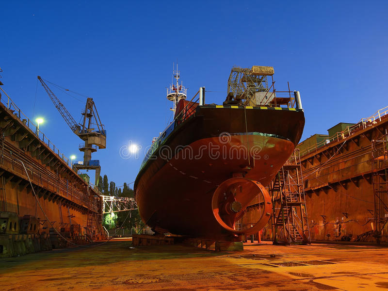 Shipbuilding. Repair of a small ship to dock stock photography