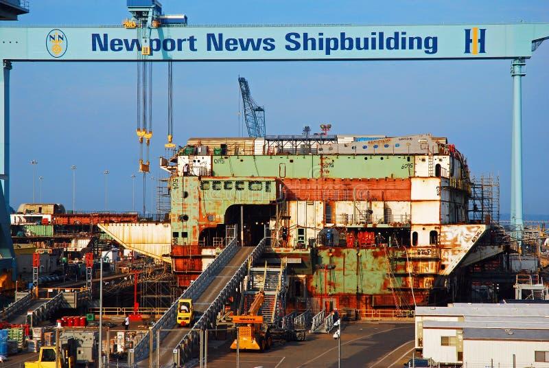 A shipbuilding center in Newport News, Virginia. Workers scurry in a A shipbuilding center in Newport News, Virginia stock image