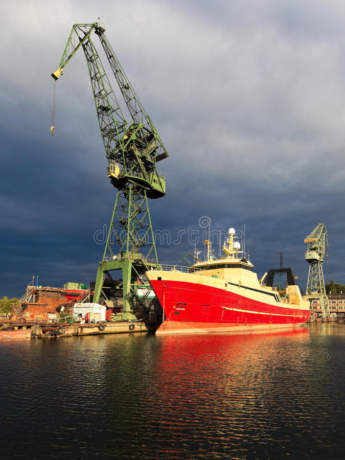 Shipbuilding industry. Dark rain clouds over the Gdansk Shipyard, Poland stock images