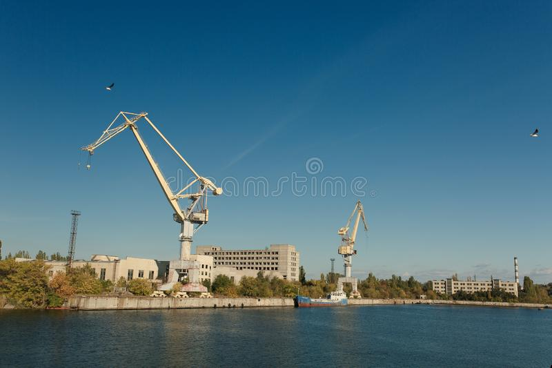 Shipbuilding plant in the city of Nikolaev, Ukraine, the largest. Shipyard of the USSR, cranes and carobs on the water stock images