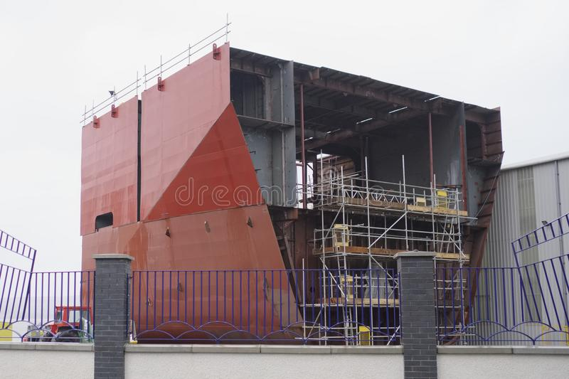 Shipbuilding in progress scaffold erected around large steel ship in yard. At Port Glasgow royalty free stock photos