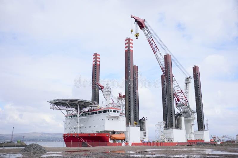Shipbuilding tower crane in progress tall at dock port harbour harbor coastal steel vessel. Greenock glasgow stock images