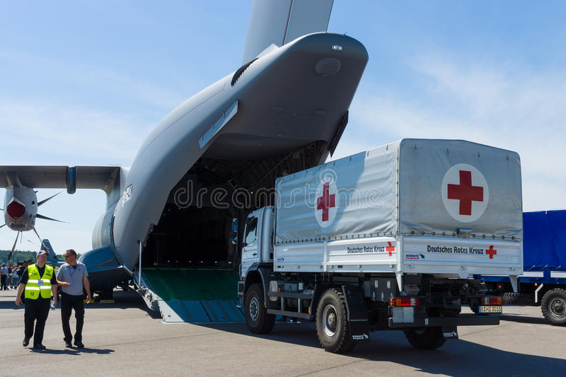 Shipment of humanitarian aid of the German Red Cross. BERLIN, GERMANY - MAY 21, 2014: Shipment of humanitarian aid of the German Red Cross in military transport stock photos