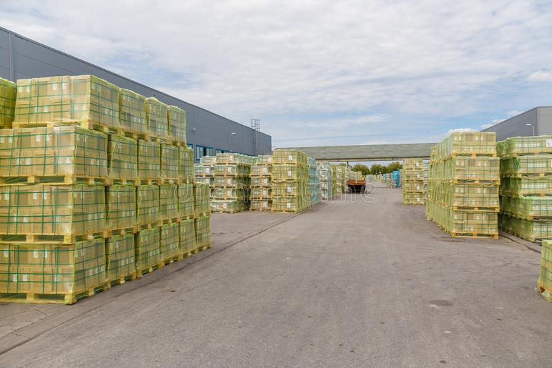Shipment, logistics, delivery and product distribution-business industry. Storage warehouse with cardboard boxes with packed goods stock photo