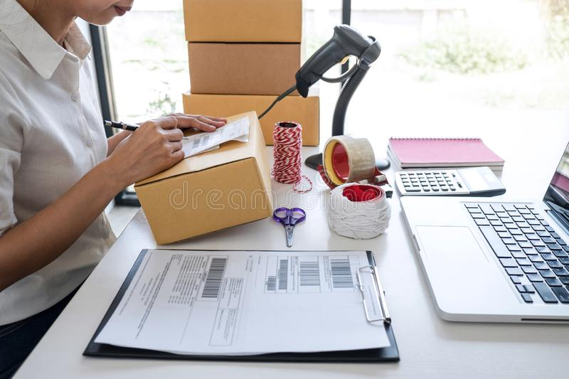 Shipment Online Sales, Small business or SME entrepreneur owner delivery service and working packing box, business owner working. Checking order to confirm royalty free stock photography