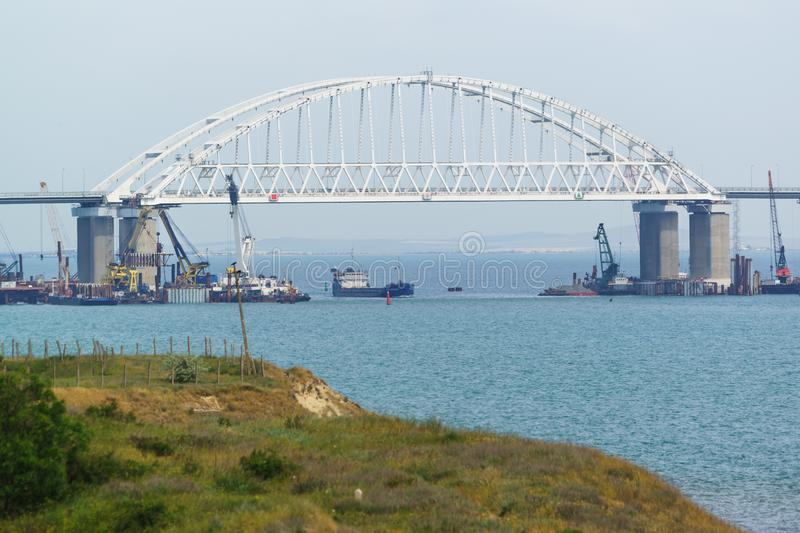 Shipping arch span Crimean bridge across the Kerch Strait royalty free stock photos