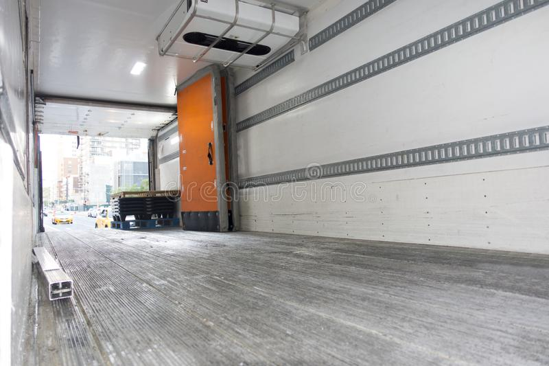 Shipping big tracktor trailer shipping truck empty cargo cabin. INSIDE AN INDUSTRIAL SHIPPING TRUCK`S CABIN EMPTY WITH A FEW THINGS AND pallets and cooling royalty free stock photography