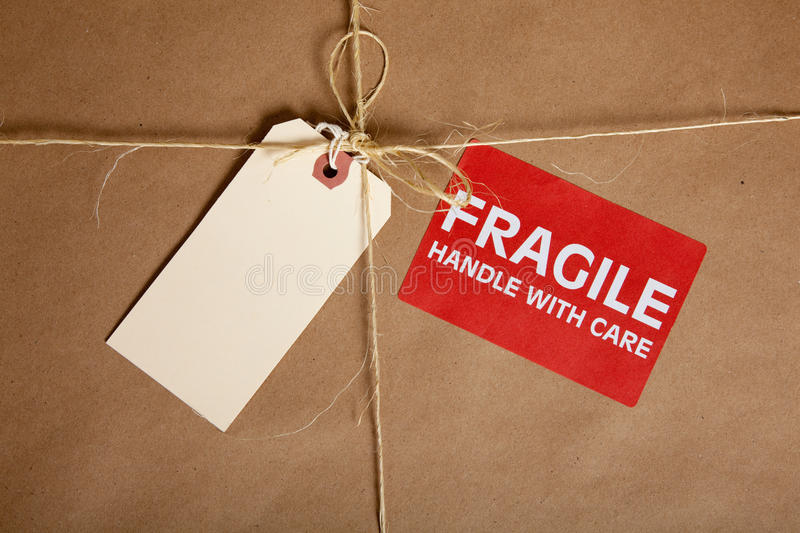 A Shipping Box With A Blank Tag And A Fragile Royalty Free Stock Photos