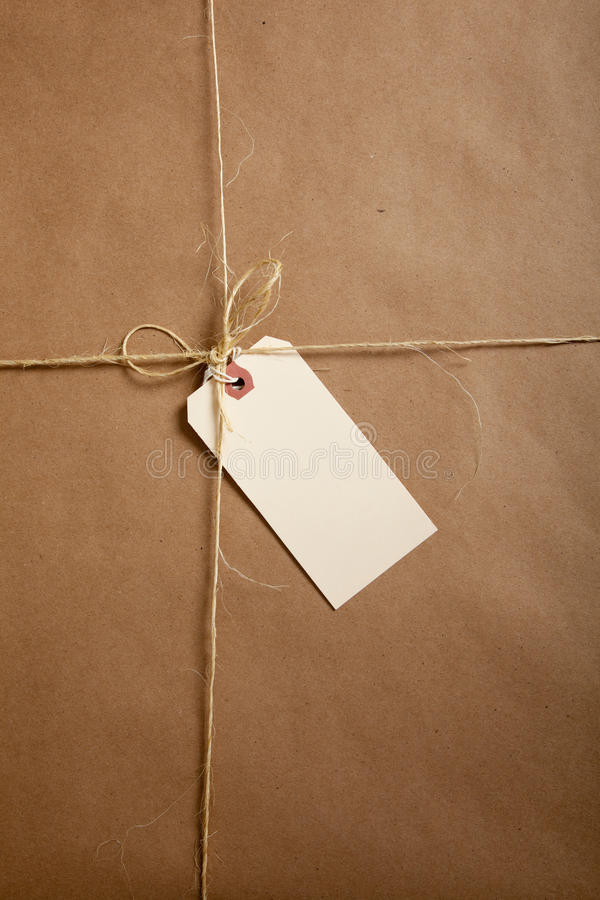 Download A Shipping Box Ties With String With A Blank Label Royalty Free Stock Photos - Image: 10640798