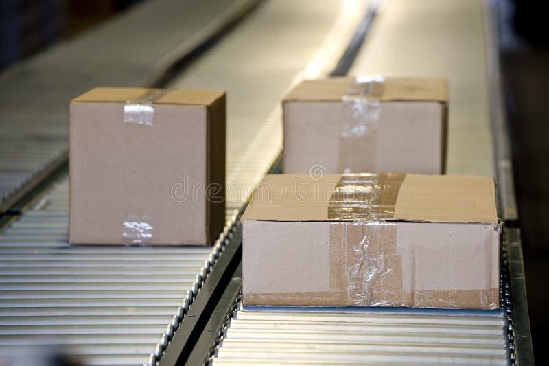 Shipping Boxes On Conveyor Belt royalty free stock photo