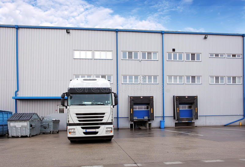 Shipping cargo truck at warehouse building royalty free stock photo