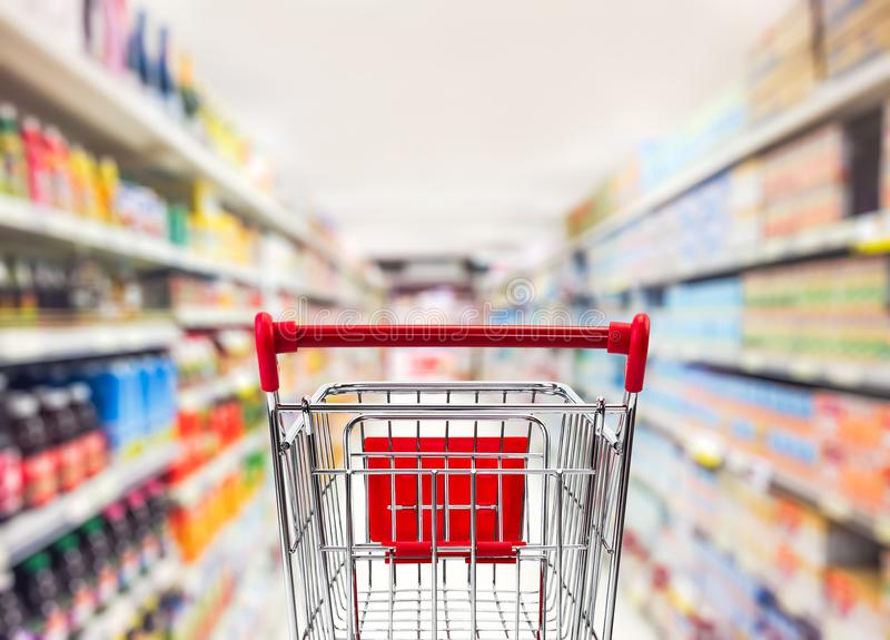 Shopping cart in supermarket royalty free stock photos