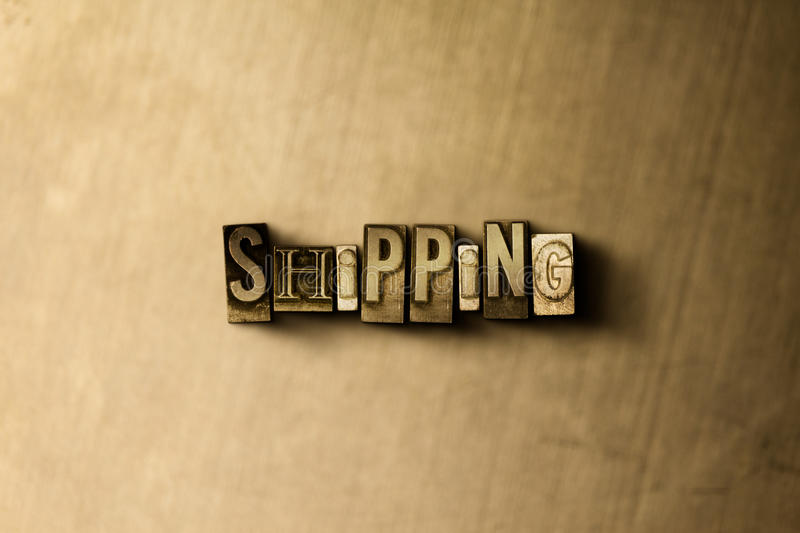 SHIPPING - close-up of grungy vintage typeset word on metal backdrop stock illustration