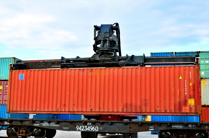Shipping container loading by richtracker on the freight rail car at logistic warehouse port. Ocean Freight Cargo Shipping, Intermodal Container Freight stock image