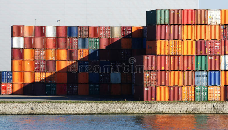 Shipping Containers. At the Port of Rotterdam. The port of Rotterdam is the largest and busiest port in Europe and is located in Rotterdam, the Netherlands stock photo