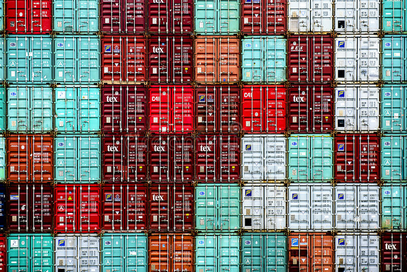 Shipping containers pattern. A colorful stack of assorted shipping containers royalty free stock photo