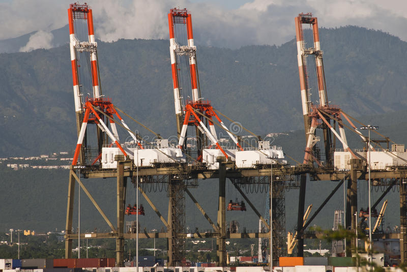 Shipping crane. Enormous shipping cranes at industrial docks royalty free stock images