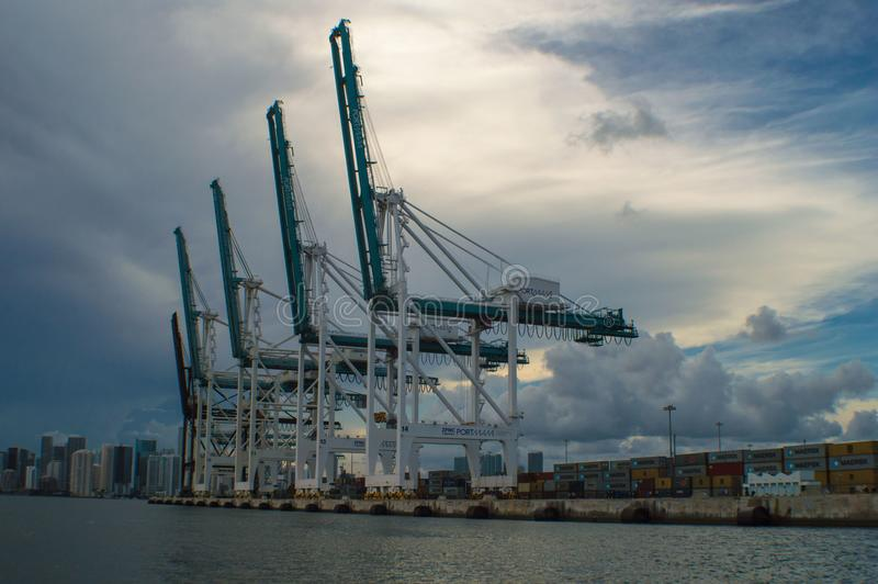 Shipping Cranes in Miami Port. Miami port shipping cranes with city in the background stock images