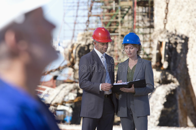 A shipping engineer with co-workers stock image