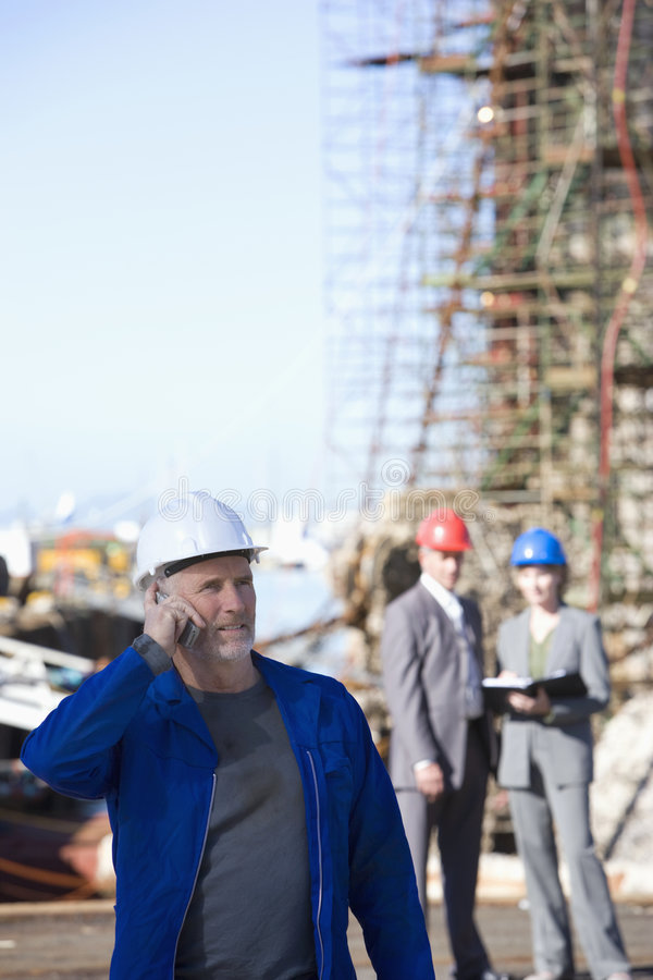 Download A Shipping Engineer Talking On Phone Stock Image - Image: 3618793