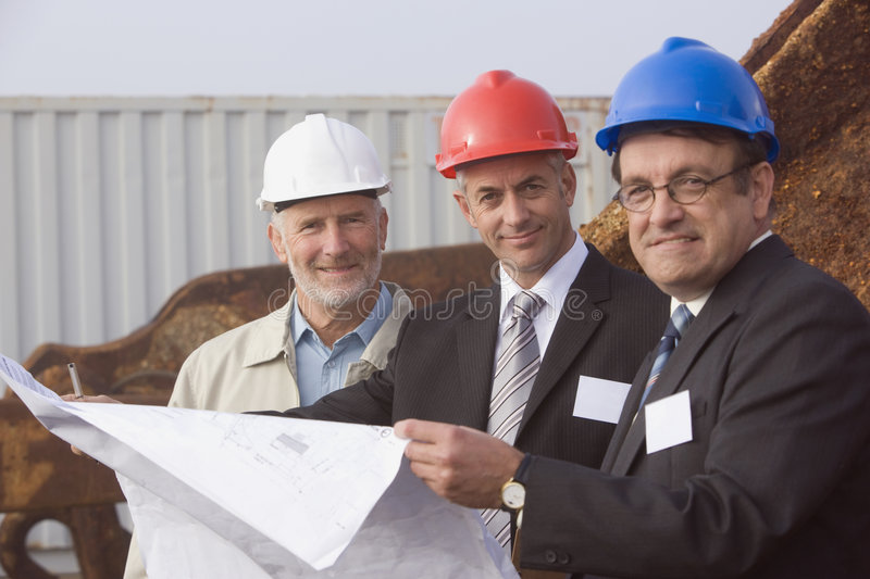 Shipping inspection engineers with plans stock photo