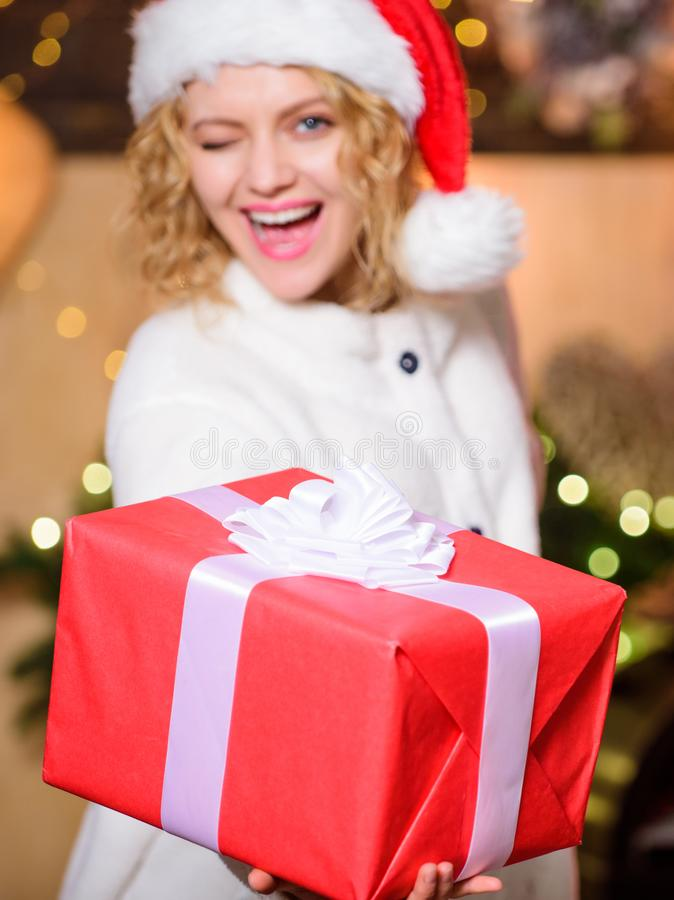 Shipping parcels. Courier delivery service. Christmas bucket list. Girl Santa hat hold gift box. Delivery services. Send stock images
