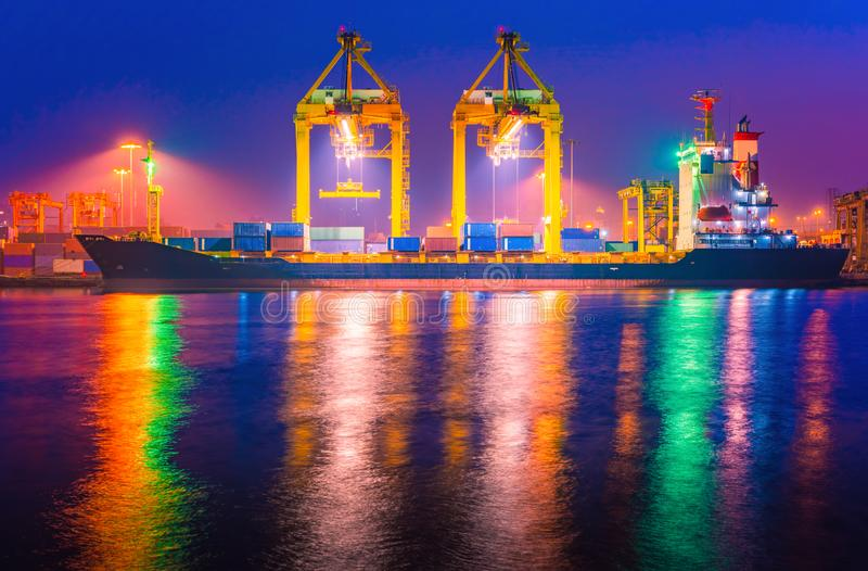 Shipping port. Logistics and transportation of international import export container cargo ship loading or unloading by crane stock photos