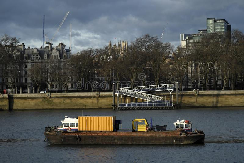 Moving freight over Thames river in uk stock photo